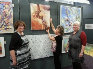 Sylvia Hawthorne (centre) who has been hanging entries for 30 years, gives some tips to Helen Pain and Judith Crowley (right)
