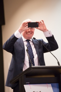 Gareth Ward takes a picture of the protest meeting to send to Premier Mike Baird