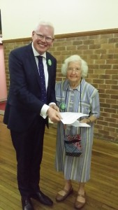 Lauris Buckman, Gerringong resident for 51 years, giving  a copy of her submission to  Gareth Ward MP.