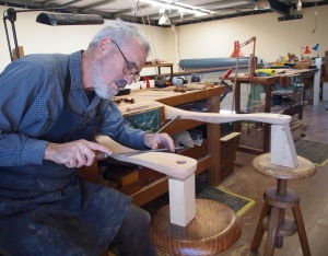Leon Sadubin shaping Monterey Cypress into the arms of a Yoke Armchair, for a modern interpretation of a squatters chair